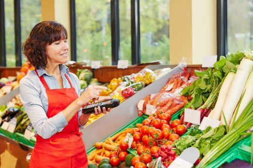 Salesperson counting vegetables for delivery